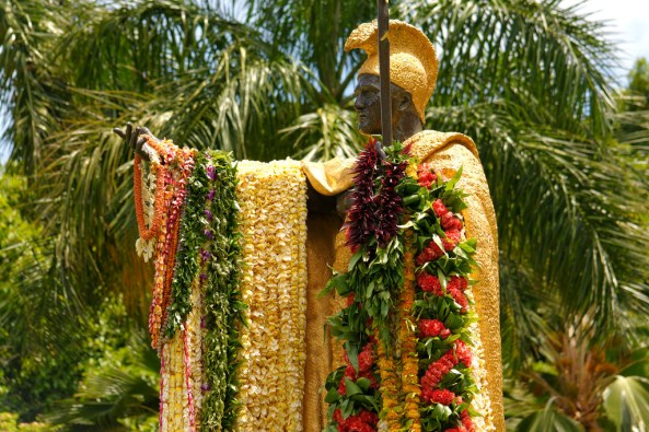 Image of King Kamehameha adorned in leis